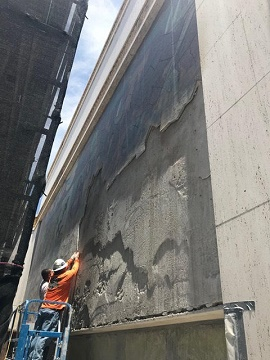 Workers remove Sheets mural